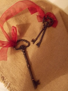 Sweet metal keys on a ribbon will look great on your tree, or anywhere else!Email me at loribchic@gmail.com, we can ship almost anything!