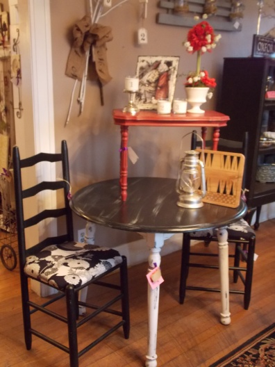 Very chic black & white table was $195, now $95 Ladder back chairs were $42, now $25