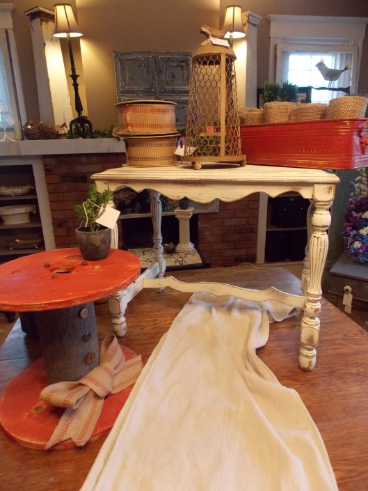 Creamy white distressed table was $60, now $48