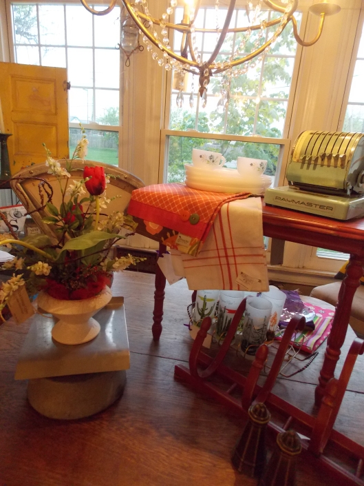 Vintage accessories add character to any vignette..I love red and turquoise